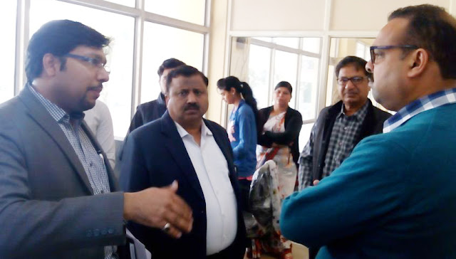 Municipal Commissioner Mohammed Shine discusses with Green Company officials