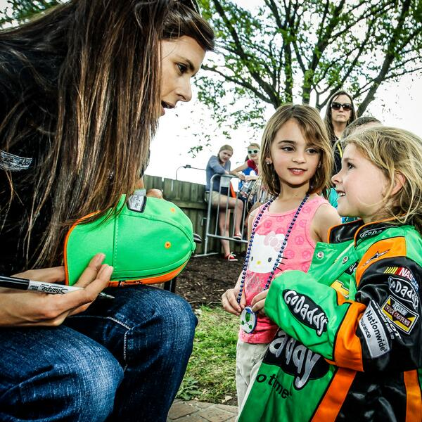 Danica Patrick signs an autograph for a young fan at RIR Toyota Owners 400