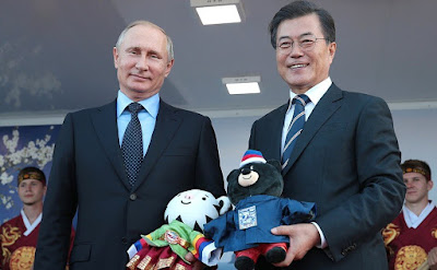 Vladimir Putin with President of the Republic of Korea Moon Jae-in during a visit to the Far East Street exhibition.
