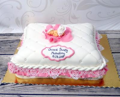 tort na chrzest poduszka