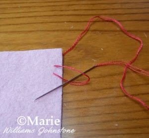 step 4 demonstrating hand sewing stitch