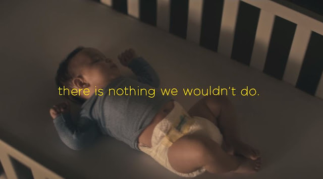 A baby fast asleep in a cot as part of Pampers #BetterForBaby campaign