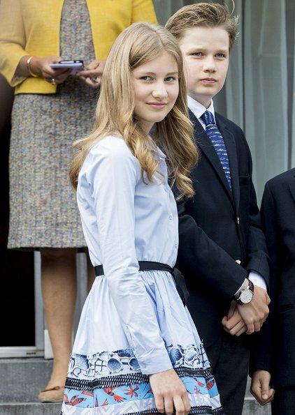 Crown Princess Elisabeth wore Zara fringed coat, Maje Poplin dress, Diane von Furstenberg floral trousers, Maje Raphael dress. Queen Mathilde