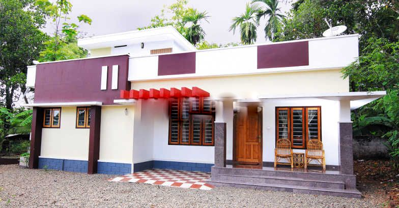 2 bedroom cute low cost effective kerala dream home in for Low cost per square foot house plans