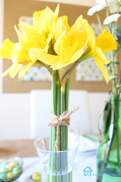 daffodil bouquet tied with jute rope inside a vase