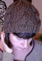 http://www.ravelry.com/patterns/library/quickie-cabled-cap