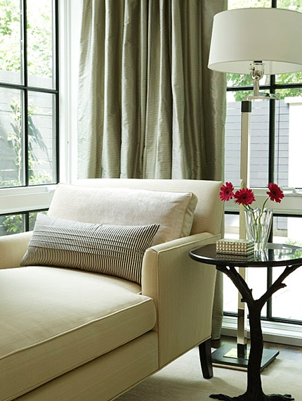Elegant chaise and silk drapes in living room by Sarah Richardson