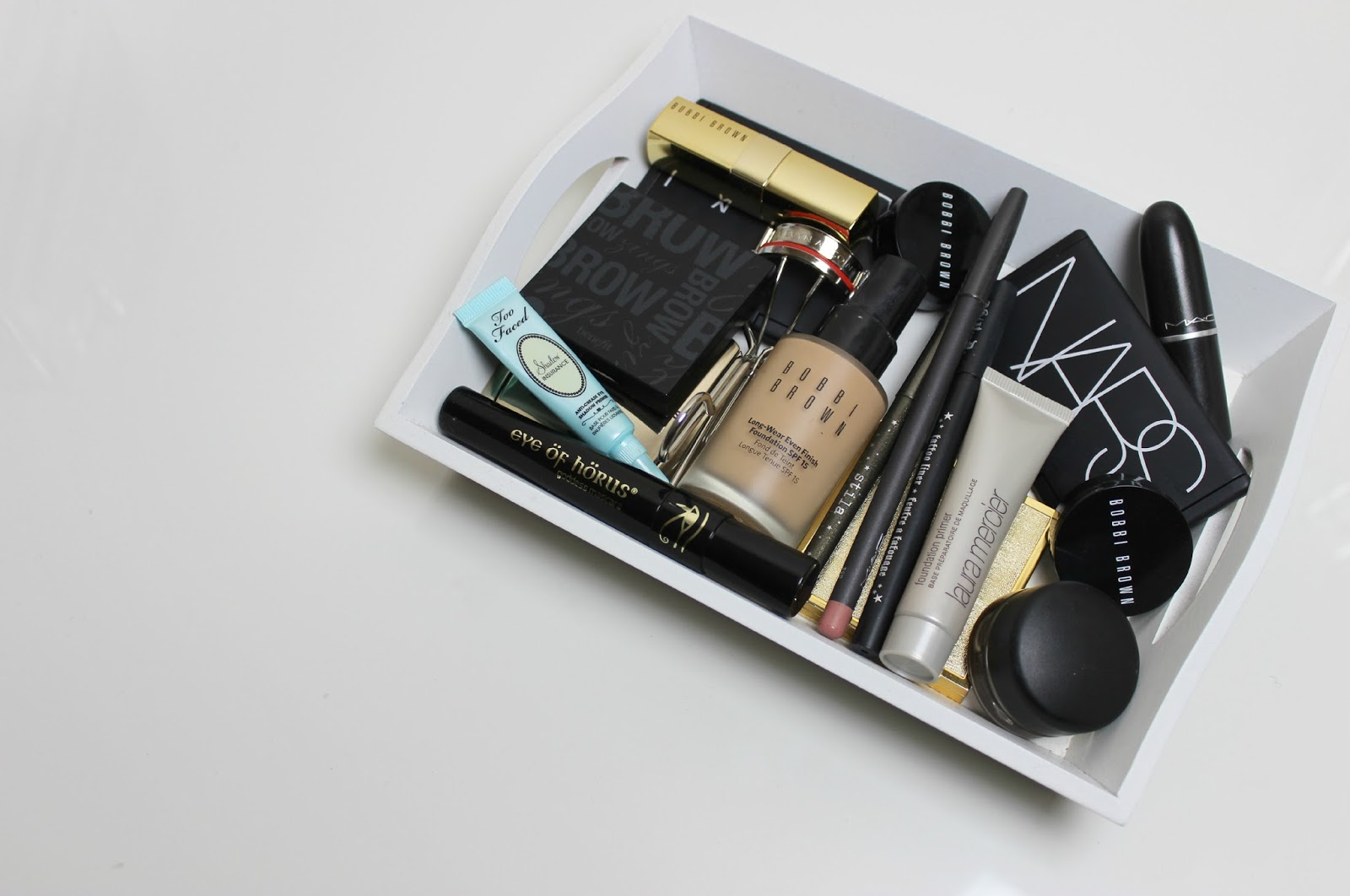 A tray of high-end makeup products