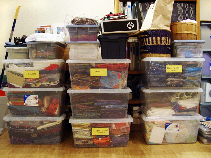 old frabric storage system: Fabrics stored in large tubs and various smaller containers