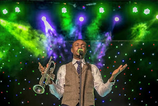 Nathaniel bassey on stage to minister