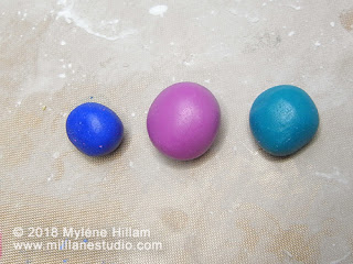 Balls of epoxy resin clay coloured with alcohol inks