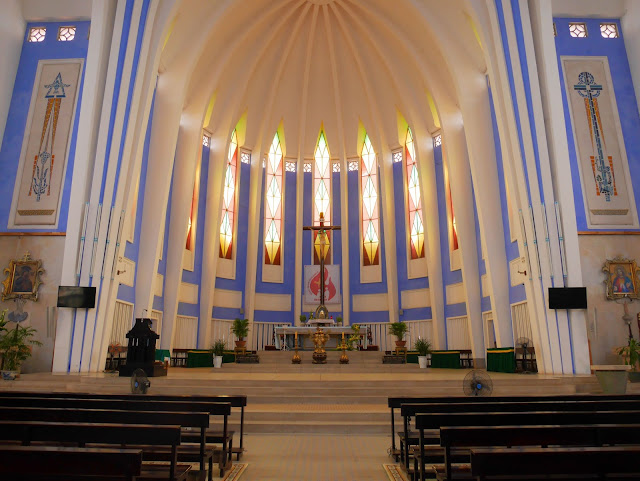 the altar of Redemptorist Church in Hue, Vietnam with stained glass
