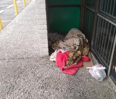 Image of The Homeless Guy asleep