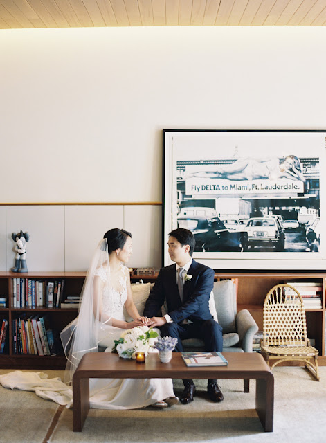 The bride and groom sitting on a couch before their vow ceremony | Karen Hill Photography