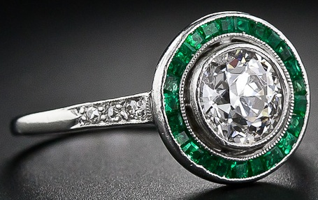 An antique Art Deco diamond engagement ring with calibre emeralds.