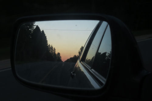 sunset reflected in rearview mirror