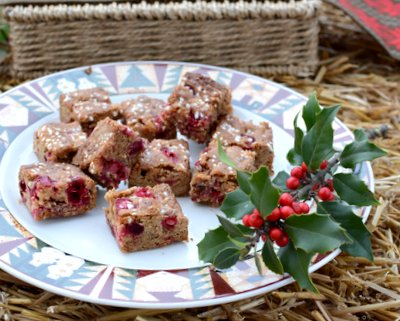 Fresh Cranberry Bars ♥ KitchenParade.com, chewy molasses-spice bars with bursts of sour cranberry and topped with a scattering of sugar 'snow'. Addictive!