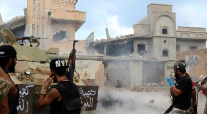 Members of the forces loyal to Libya's UN-backed Government of National Accord (GNA) fire their weapons at enemy positions in Sirte on August 28, 2016. By Mahmud Turkia (AFP/File). Sirte (Libya) (AFP) - Forces loyal to Libya's Government of National Accord (GNA) said Saturday they have launched a new attack on diehards of the Islamic State group in the coastal city of Sirte.