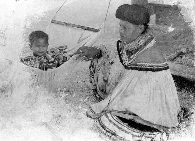 Miccosukee mother rocks her baby in a hammock, between 1033 and 1960