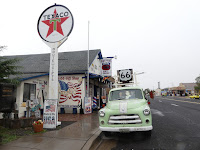 Route 66 sign, old Texaco Sign and old car