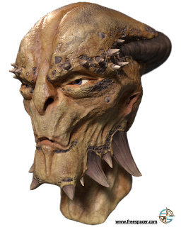 The bust of an alien with spiked brow and jawline and large eyes, and a protrusion of the back of their skull, and tan skin.