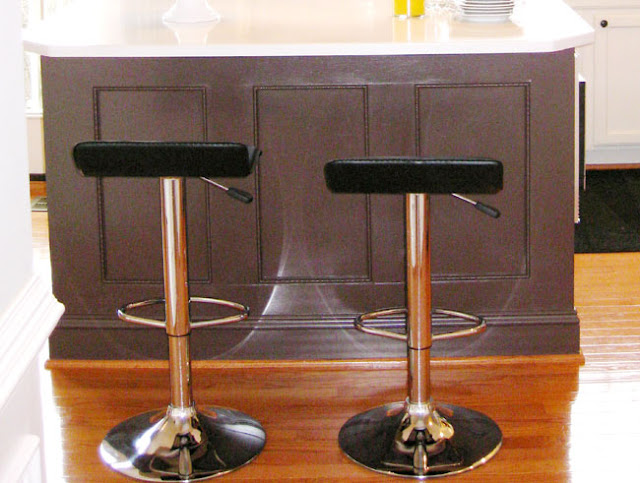 BM Tudor Brown kitchen island with pair of Winsome wood air lift adjustable stools