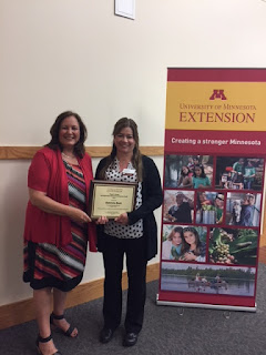 Financial Capability Educator Gabriela Burk, right, with Extension Dean Beverly Durgan