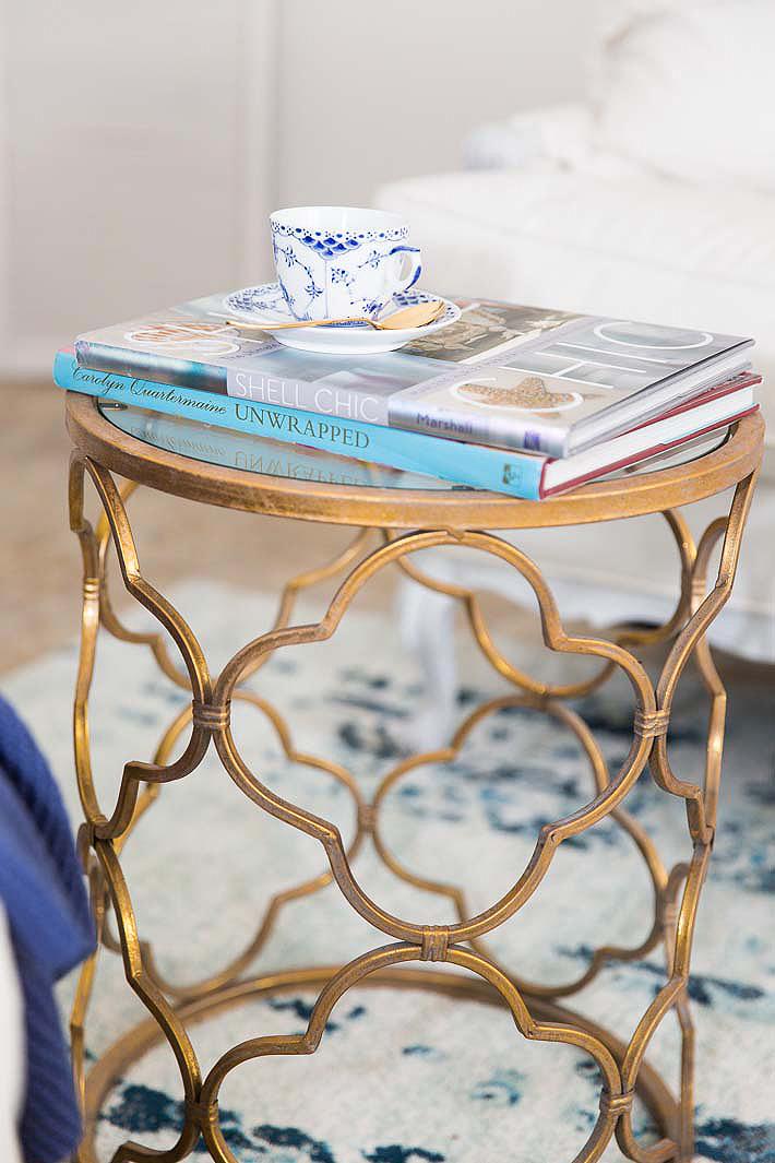 gold quatrefoil table
