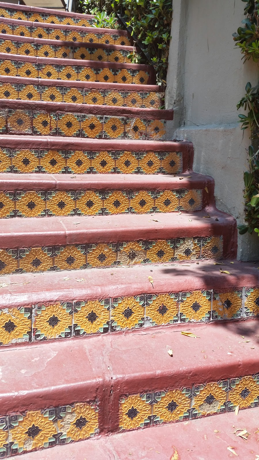 These stair risers are tiled with a sunflower motif