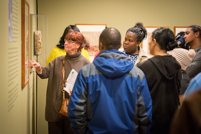 Clemente class of 2019 explores the galleries with one of their teachers.