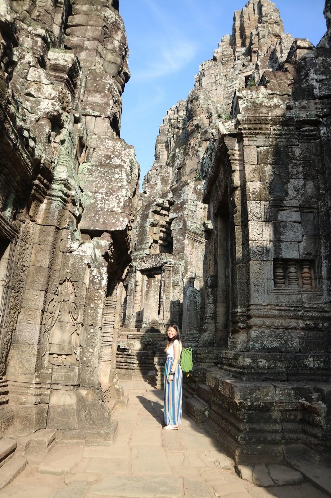Exploring the ruins of Bayon Temple