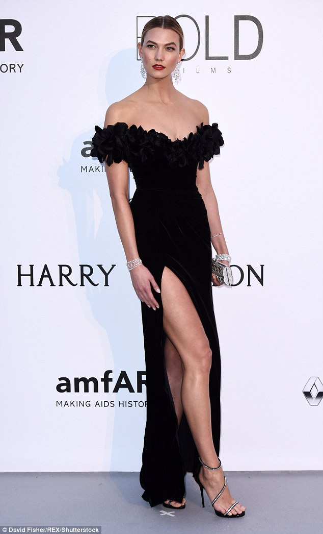 Karlie Kloss is sexy in an off shoulder gown at the amfAR Gala in Cannes