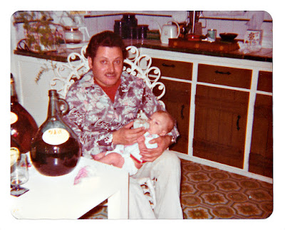 Julio Enrique Mejia relaxing with a white baby and some Almaden wine.