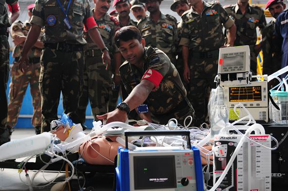 An Indian Air Force medic provides emergency response on a mannequin patient during a U.S. Air Force medical demonstration as part of exercise Cope India 2009. (U.S. Air Force photo/Capt. Genieve David)