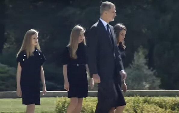 King Felipe, Queen Letizia, Princess Leonor and Infanta Sofia observed a minute's silence for victims of the coronavirus. Felipe Varela dress