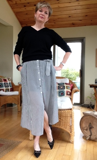 Black Banana Republic v-neck sweater, black and white striped ALC midi skirt, black and grey Stuart Weitzman kitten heel pumps