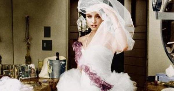 amomadonna madonna wearing her wedding dress 16th august