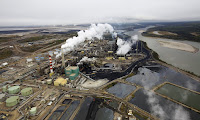 A Suncor tar sands processing plant near Fort McMurray in Alberta, Canada. Carbon Tracker says the big oil companies should abandon high-cost tar sands schemes. (Photograph Credit: Todd Korol/Reuters) Click to Enlarge.