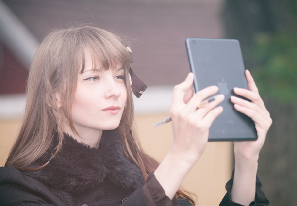 a classic lolita checking her makeup with the ipad's front camera