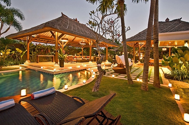 Backyard of the Villa Asta, Rental Vacation Villa, Bali with the pool, chairs, and shaded places for residents