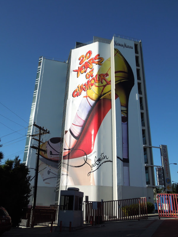 Giant Christian Louboutin show billboard