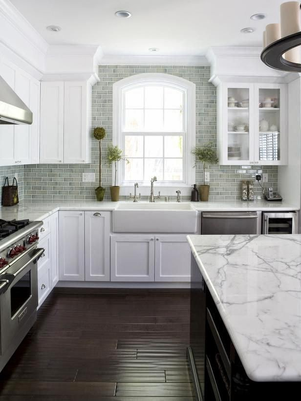 White kitchen with dark flooring