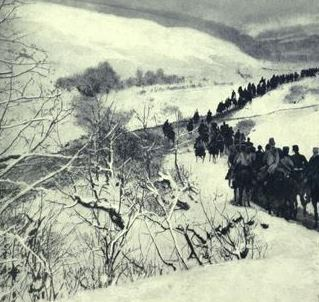 """Russian Troops Moving to the Attack in the Carpathians  This photograph was taken by Captain Adrian Simpson, acting A.D.C. to the Grand Duke Michael Alexandrovitch, commander of the Caucasian Native Division, operating in Galicia. The troops are seen passing through a defile in the Carpathians and across a tributary of the River San."" (From The War Illustrated Album DeLUXE - published 1915)"