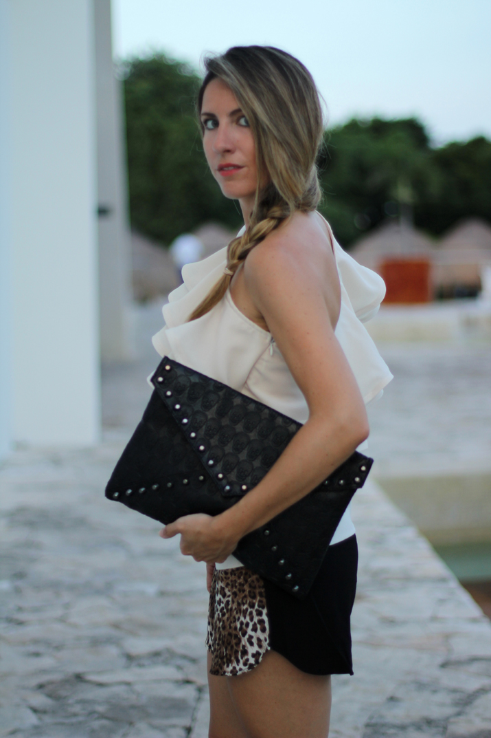 Outfit trends for summer 2012: ruffles top and leopard with envelope clutch.