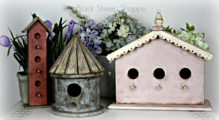A variety of birdhouses painted with chalk paint.