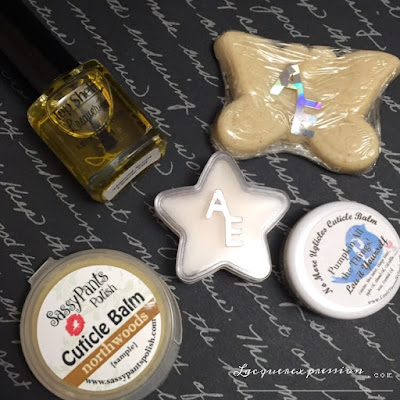 Almond scent cuticle oil from Top Shelf; First Love cuticle balm and oatmeal soap by Alter Ego; Pumpkin all the Things! cuticle balm by Lou It Yourself; Northwoods cuticle balm by Sassy Pants