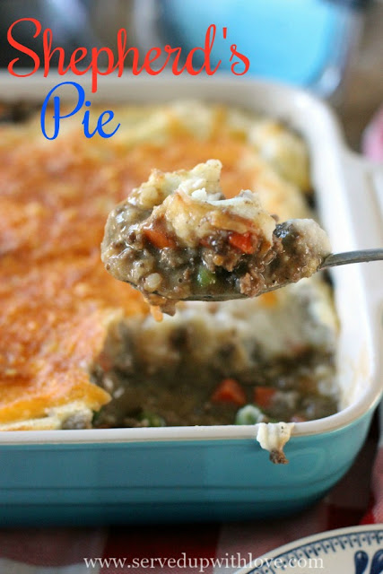 Shepherd's Pie recipe from Served Up With Love is comfort food at its finest. Gravy soaked beefy goodness with peas and carrots smothered in creamy, cheesy mashed potatoes.