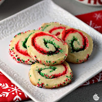 Santa's Swirl Sugar Cookies | by Renee's Kitchen Adventures - Easy holiday cookie recipe that transforms sugar cookies into a festive sweet treat with red and green colored sugars!