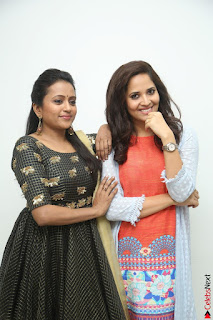 Actress Suma in Black Salwar Suit and Anusuya in orange Dress at winner movie press meet part 1 February 2017 (36).JPG
