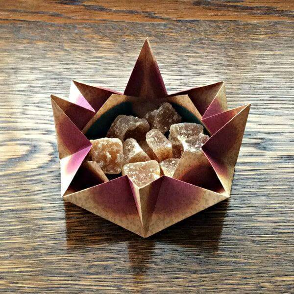 origami paper candy dish filled with ginger candy